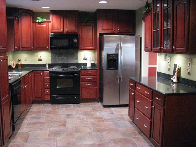 Porcelain tile plank floors with cherry cabinets been for What color paint goes with cherry cabinets