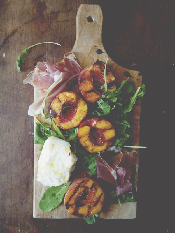 Grilled fruit with burrata, arugula & prosciutto. I think this would be so good with white wine
