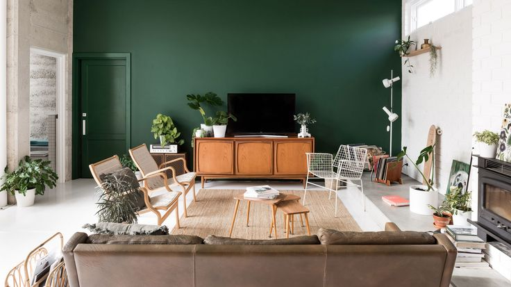 dark green walls + mcm + plants + white floors + relaxed modern living room design