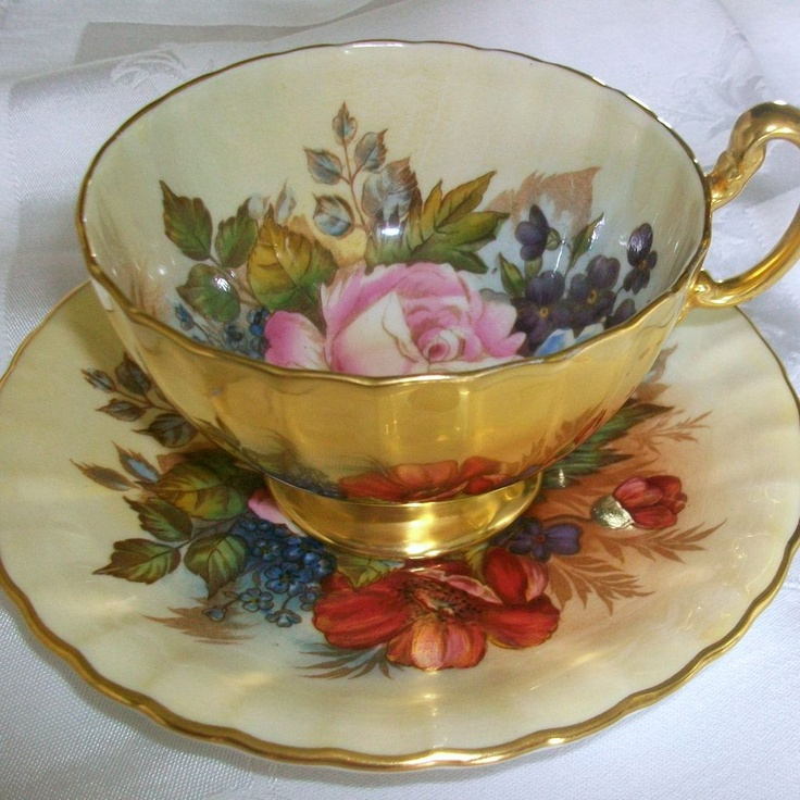 This Aynsley teacup and saucer was hand painted in 1930s and signed by the artist.  It would be a beautiful wedding or shower gift.