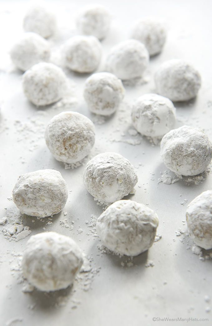 Pecan Snowball Cookies also known as Wedding Cookies are a traditional cookie made with a shortbread type dough mixed with chopped pecans, then rolled in powdered sugar for a festive and sweet finish.