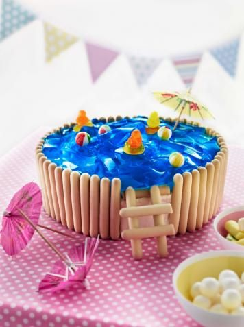 Jelly Pool Party Cake...we would use just blue icing but I like the breadstick crackers around the sides and for the ladder!