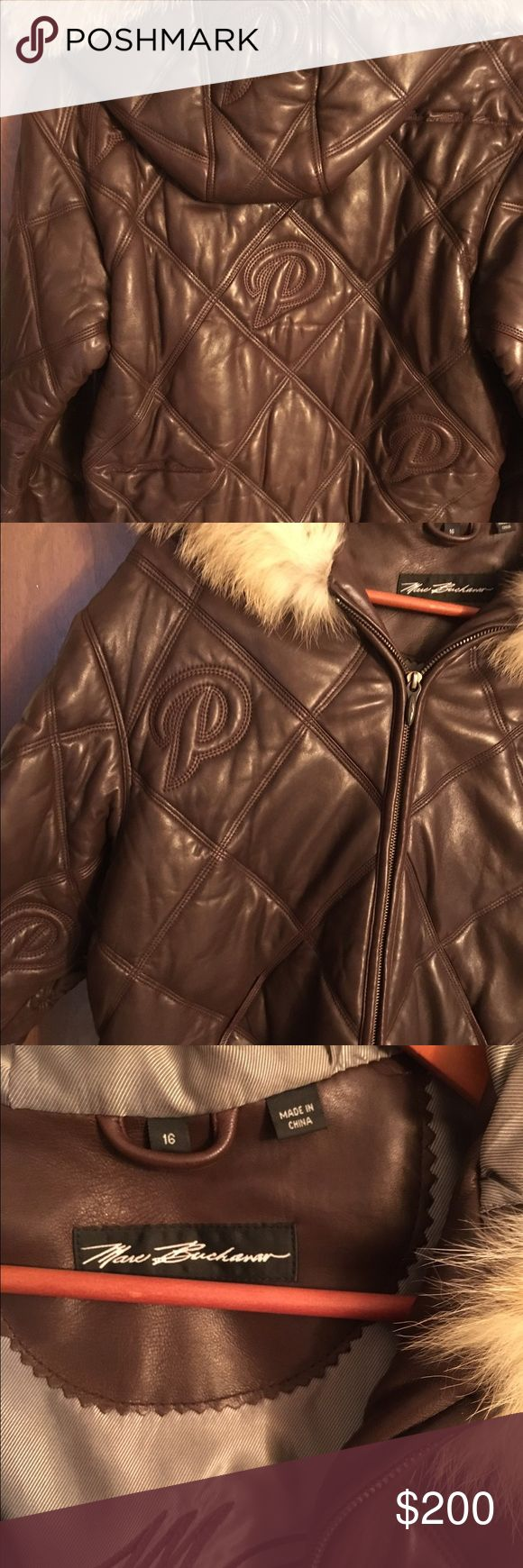 Pelle Pelle Jacket Unisex brown leather bomber. Fur trim around the hood. Excellent condition! Smoke free pet friendly home. Marc Buchanan Jackets & Coats Puffers