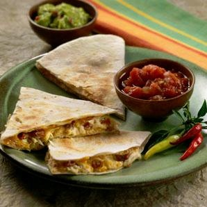 Cheesy Chicken and Bacon Quesadillas  Ingredients:  1 cup garden vegetable cream cheese, softened  1 cup shredded Mexican cheese blend  1 (10-ounce) can Hormel® Chunk Breast of Chicken, drained and flaked  1/2 cup Hormel® Real Crumbled Bacon  6 CHI-CHI'S® 8 inch Flour Tortilla Soft Taco Size  Directions:    1) In medium bowl, stir together cream cheese, chicken, bacon and shredded cheese; mix well. Spread chicken mixture evenly over tortillas. Fold tortillas in half.  Directions Continued…