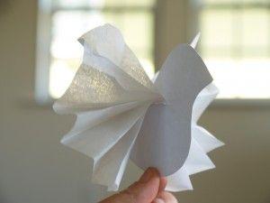 Paper Peace Dove Ornaments: materials: white card stock, white tissue paper, scissors, string