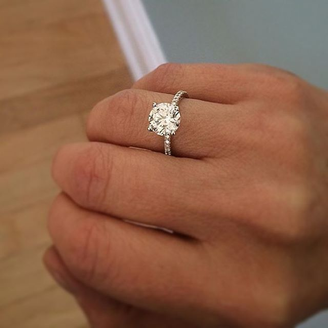 DREAM! Round brilliant cut solitaire engagement ring on thin 4 prong micropave eternity band