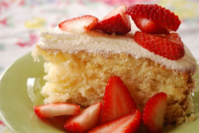 Buttermilk Cake topped with whip cream and strawberries. @ ...