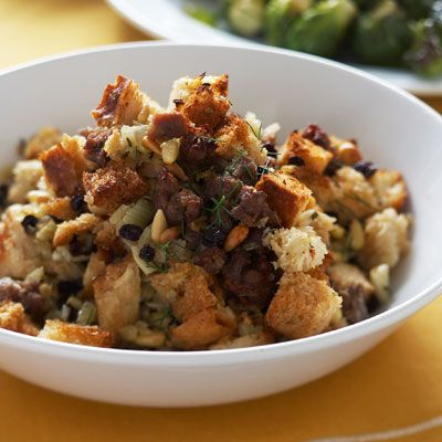 Three breads  brioche, baguette, and sourdough  provide the delicious base for sausage, fennel, pine nuts, currants, and flavorful herbs in this must-taste stuffing.