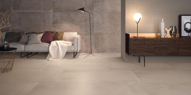 Living con pavimento e rivestimento in gres effetto cemento. Colore Clay
