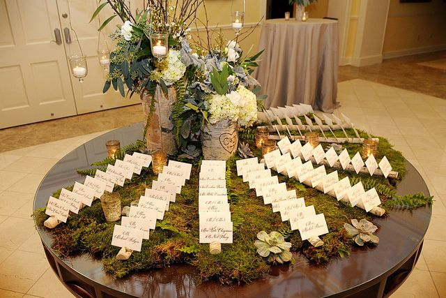 Calligraphy on escort card table with birch logs