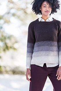 Color inversion sets this elegant pullover apart. A five-color Loft gradient graces the lower torso and sleeves, with a snowfall of stranded colorwork blending the transitions. The yoke is a modified raglan with novel repositioning of the decreases to form plumes of flowing stitches. Gentle A-line shaping and a ribbed neckband wide enough to allow layering make this piece easy to wear and love. Consider a soothing run of greens, blues, or greys as alternative palettes.