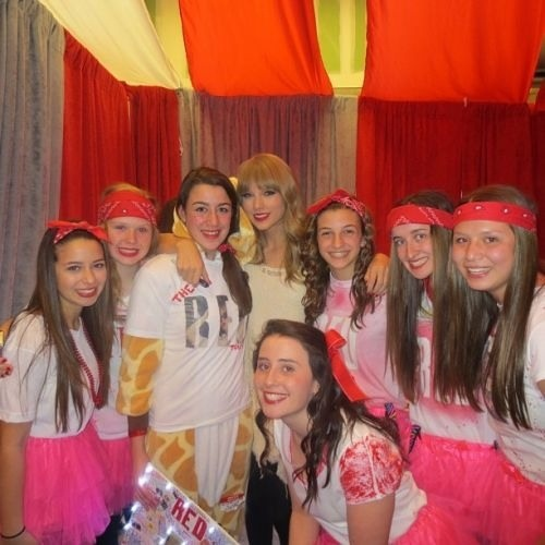 Taylor Swift at Club Red with a group of fans
