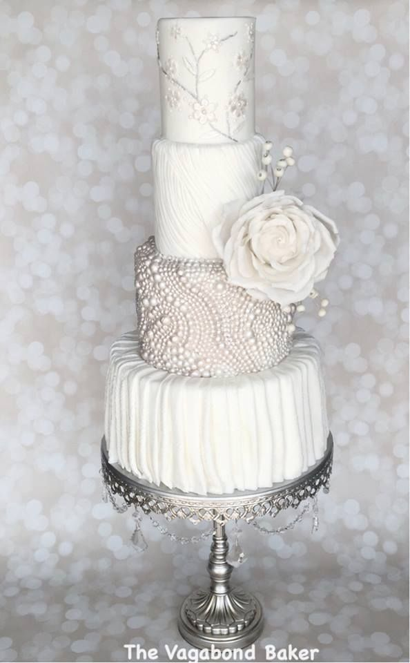 Giant sugar Roses,pearls and pleats white tiered wedding cake by Vagabond Baker