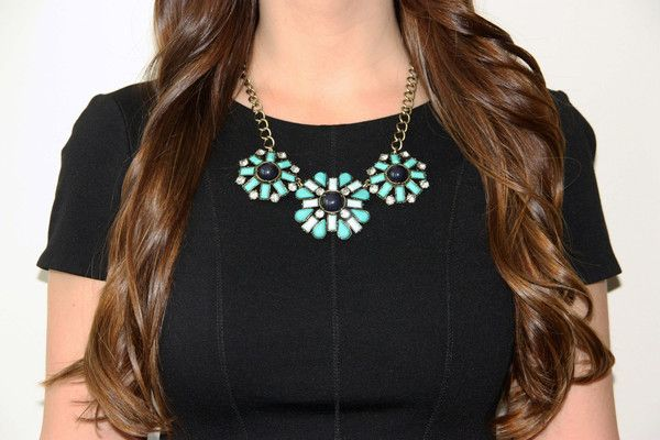 Leap into summer with this vintage flower-inspired necklace featuring bold turquoise gems.