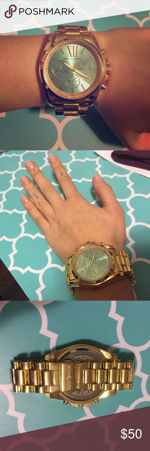 """MK gold and teal face oversized watch First, this watch is N O T auth. So please know that before purchasing. Gold tone watch with a beautiful teal face. Oversized face. Battery is dead. No scratches on face, some on the links. Doesn't come with extra links, will fit a small wrist. Perfect fashion statement. Back says this is """"stainless steel"""" and water resistant. The 3 smaller faces are for show, don't work with battery. Please feel free to ask me any questions!  Michael Kors Accessories…"""