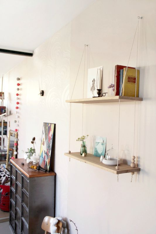 Hanging shelves with wooden beads