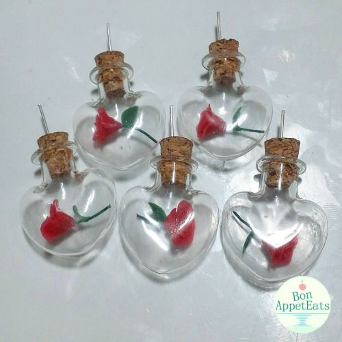 Restocking my Alistair rose bottle necklaces today. I have 4 available for next day shipping! https://bonappeteats.etsy.com #handmade #polymerclay #miniatures #dragonageorigins #alistair #rose #flowers #etsy