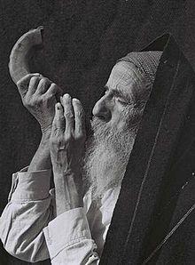 Yemenite Jewish man blowing a Shofar, 1947. (Wikipedia)