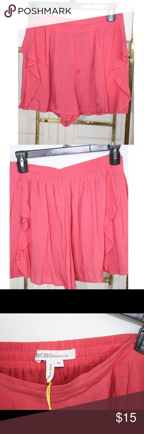 BCBG pink ruffle shorts Very flowy and fun shorts. Great for summer. Stain on he front as shown in pics but shouldn't be permanent and can probable get off in the wash BCBGeneration Shorts
