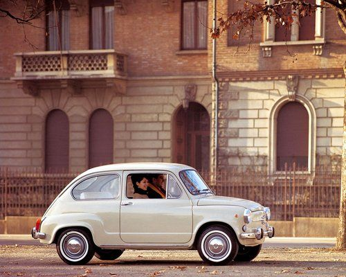 Fiat 500,. Classic... I used to have one of these in High School. LOL  Loved it, and my friends all called it Bright eyes. :-)