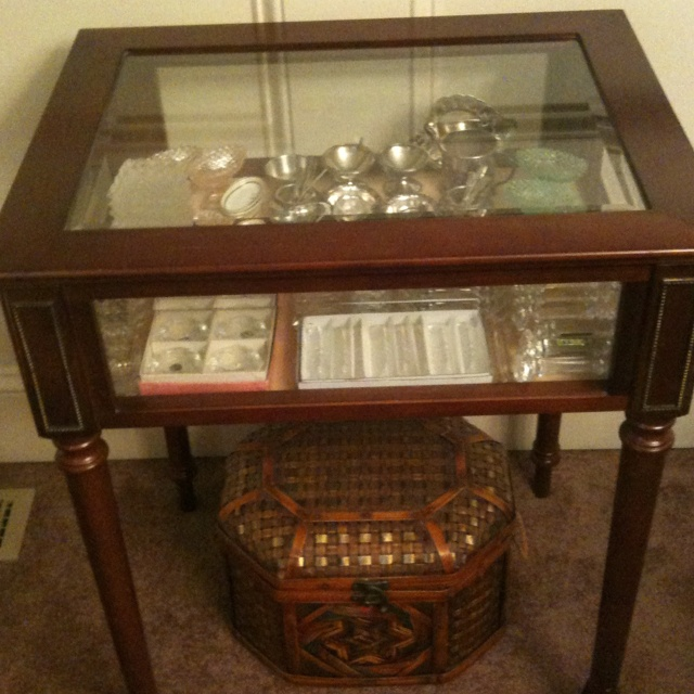 Bombay Co. Curio Table Displays Knife Rest Collection In Dining Room.