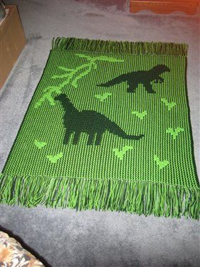 I know some little boys who would love this crochet afghan.  Dinosaur afghan by lanesgma