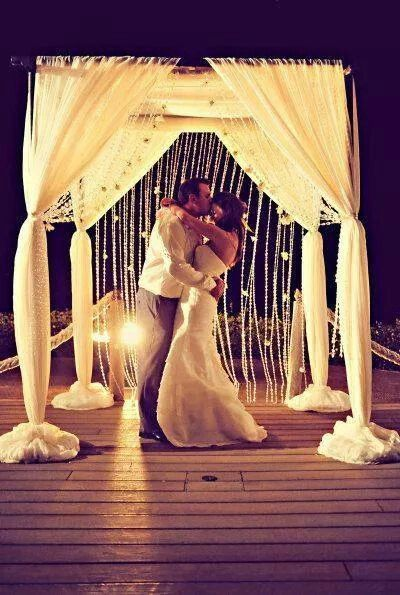 Love the flower and crystal string backdrop