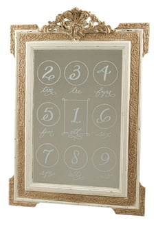 A vintage-style mirror handwritten with table numbers (in Swedish, too!) helps guests find their seats.    Mirror, Wisteria; calligraphy, love*jenna