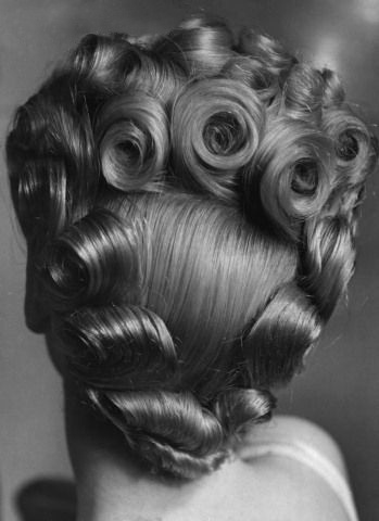 All of these 30's/40's updos are fabulous... but how does the modern woman find the time to compete with this??