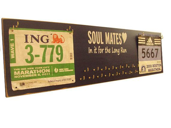 race bibs and race bibs and medals holder -We've always wondered what to do with our bibs and medals.  Here's an idea.
