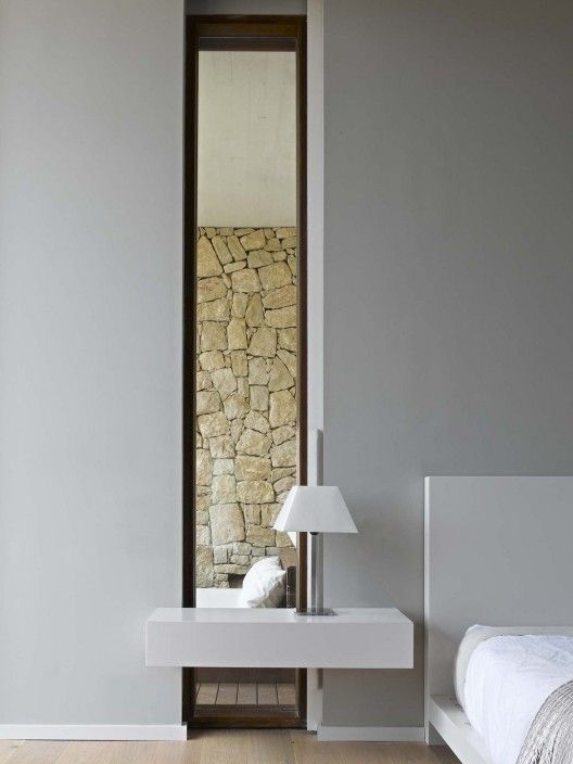House in Monasterios: Interesting window - goes all the way to the floor behind the built-in bedside table. | Ramon Esteve architect via archdaiy