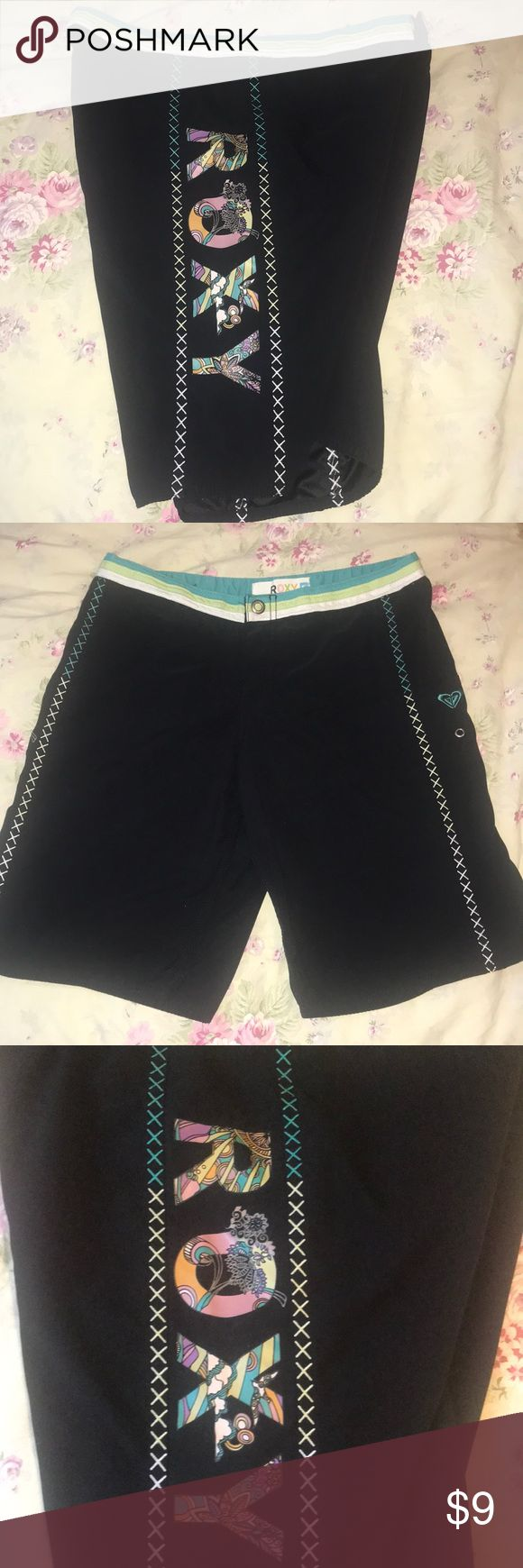 Roxy black long board surf shorts Bermuda size 7 Roxy Size 7 Good pre-owned condition, the waist band white is not so bright. I have a bunch of long surf swim shorts going up and I love to bundle. 100% polyester Roxy Shorts