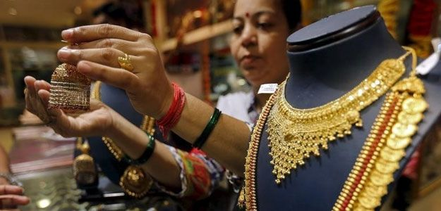 Gold prices could rise above $1,200 an ounce in the next few months as fears of a currency war following the devaluation of the yuan make equity markets choppy,