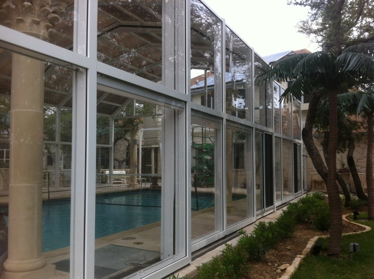 Large pool enclosures for all your fun great retractable for Retractable pool enclosures canada