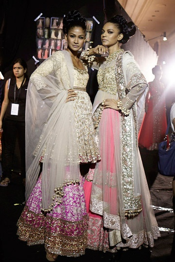 Models Carol Gracias and Noyonika Chatterjee pose backstage at Manish Malhotra