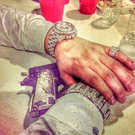 Diamond-studded jewellery and guns are all part of the social media show put on by members of the Sinaloa Cartel
