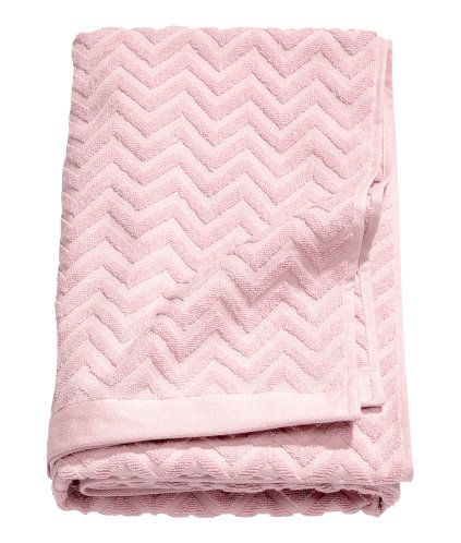 Light pink. Bath towel in cotton terry with a jacquard-weave pattern.