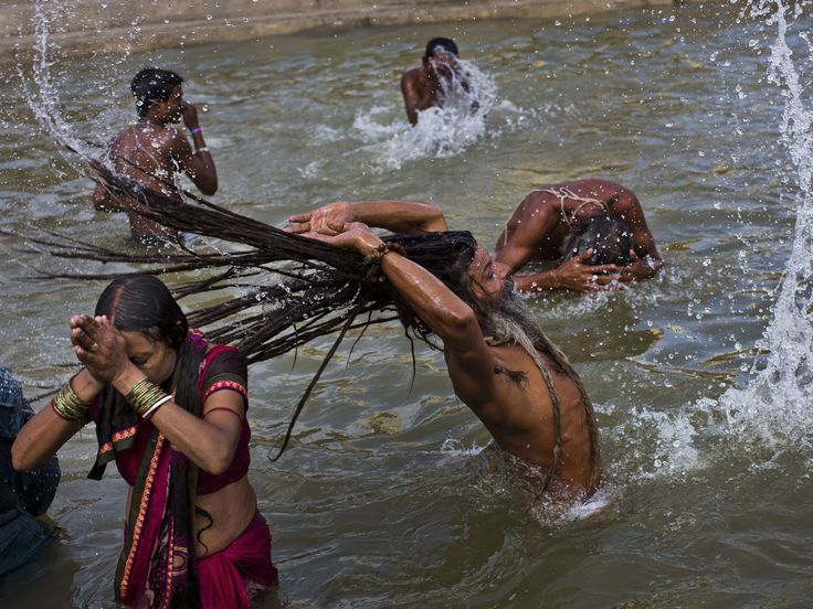 Hindu devotes take a bath in the Godavari River during Kumbh Mela, or Pitcher Festival, in Nasik, India. According to Hindu mythology, the Kumbh Mela celebrates the victory of gods over demons in a furious battle over a nectar that would give them immortality. As one of the gods fled with a pitcher of the nectar across the skies, it spilled on four Indian towns- Allahabad, Nasik, Ujjain and Haridwar.  Bernat Armangue, AP