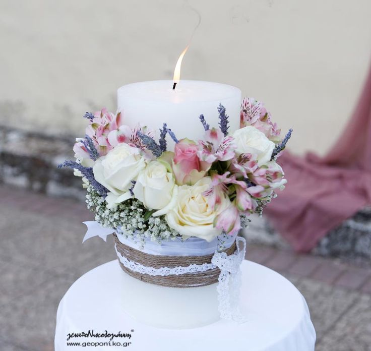 roses, lavender, alstroemeria, gypsophylla for the wedding candle