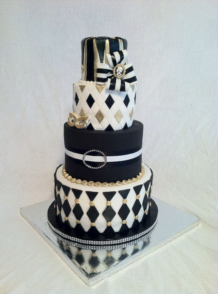 Harlequin Halloween Party Cake Harlequin Halloween Party Cake The client had just asked that the cake be tall, black, white & gold, some kind of diamond pattern and... #halloween #halloween-cake #wedding #cakecentral