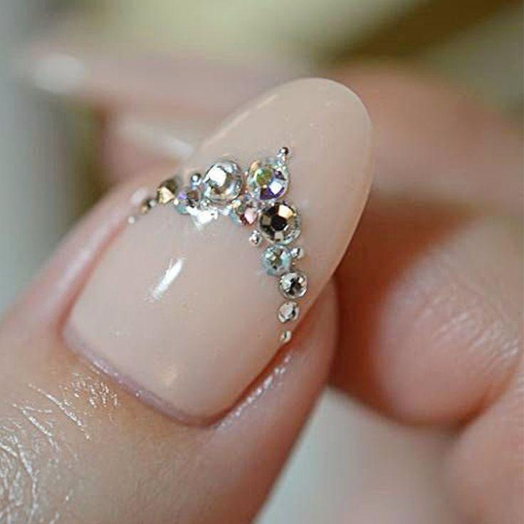 Nude and crystal nail art.