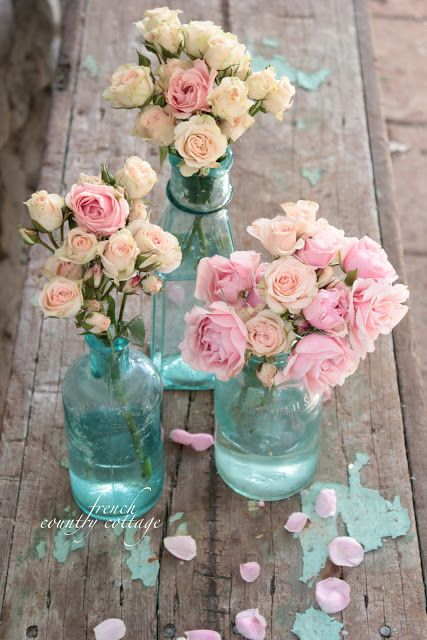 I love the color of these bottles and how beautifully they go with the pinks of the roses! Gorgeous photography by FRENCH COUNTRY COTTAGE: Vintage Blue Bottles