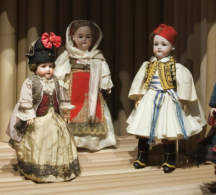 "In 1914 during the First World War, Queen Olga ""trapped"" in Russia in one of her letters to Ioulia Carolou asked her to donate the dolls to the Lyceum of Greek Women, which is known for its contribution to the preservation of the cultural heritage. - Museum of Greek Folk Art , Athens"