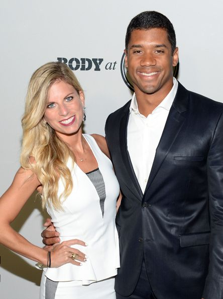 Russell Wilson, quarterback of the Seattle Seahawks, and his wife, Ashton Meem since high school.  They love dogs' they own three pups, and one daschund.  .
