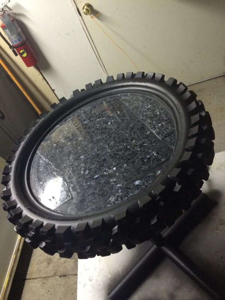 A table I made from a old dirt bike tire and scrap pcs of granite