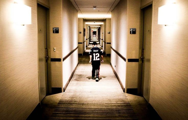 Kullen is ready for the @patriots game today! He's rockin' his @tombrady jersey as he struts down the hallway of the hotel!  #patriots #tombrady