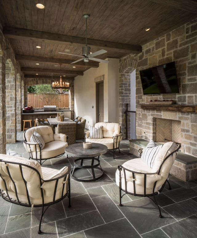 Covered patio, beams on ceiling, concrete etched lines. What about having grill facing back of property?