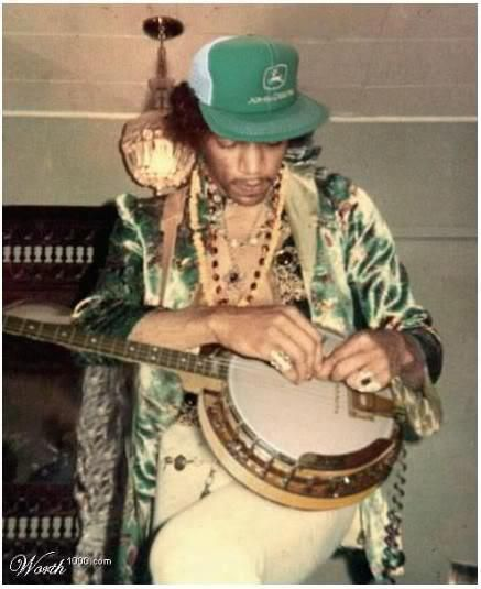 jimi @musicbizmentor.com ; jimi hendrix on banjo.  I wonder if it's right handed strung left???