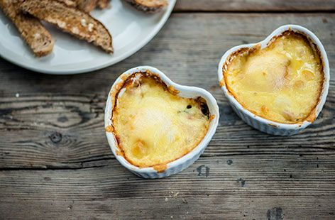 We think these baked eggs will be just what you need for breakfast in bed - make sure to serve with some toasted Vogel's for special toasty dunking!