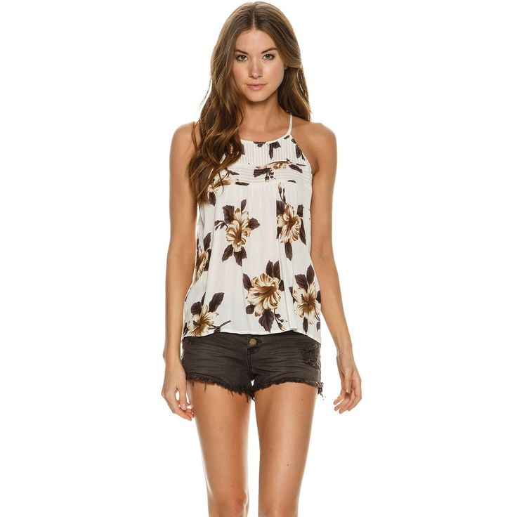 "O'Neill Olympia Woven Tank.     Women's top.     Relaxed fit.     High neckline.     Slim straps.     All-over floral print.     100% Rayon.     Imported.     Vendor Style #: SU7404015.        Size & Fit Guide     Model is wearing size Small.   Model's height: 5'10""   Model's chest: 32 inches.   Model's waist: 23.5 inches.   Model's hips: 34 inches."